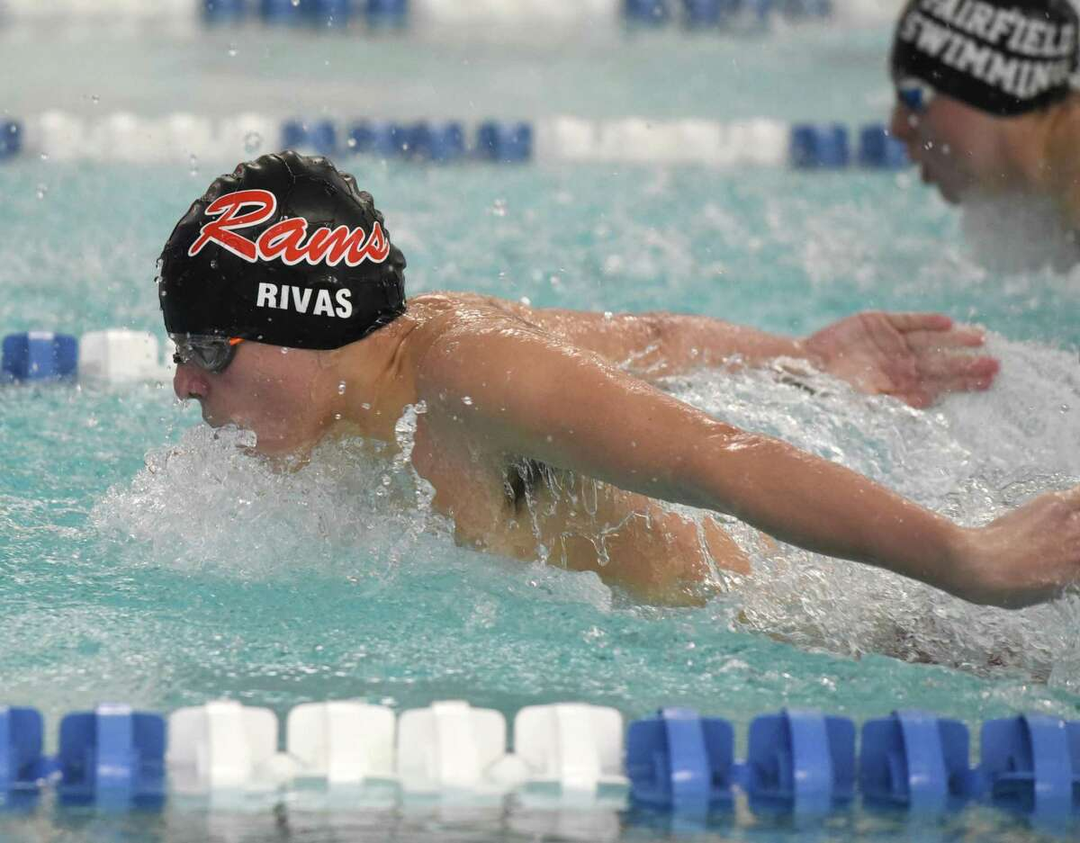 New Canaan's Michael Rivas competes in the 100 butterfly during a swimming and diving meet between New Canaan and Ludlowe at the New Canaan YMCA on Friday, Jan. 31, 2020.