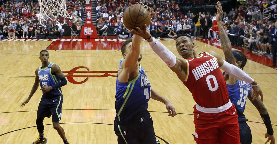 Houston Rockets guard Russell Westbrook (0) shoots the ball while defended by Dallas Mavericks forward Maxi Kleber (42) and center Willie Cauley-Stein (33) during the second half of an NBA game at the Toyota Center Friday, Jan. 31, 2020, in Houston. The Rockets won 128-121. Photo: Godofredo A Vásquez/Staff Photographer