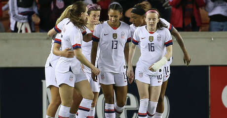 The United States celebrate Lynn Williams' (13) goal at the second minute of the first half of the CONCACAF Women's Olympic Qualifying Tournament match against the Panama Friday, Jan. 31, 2020, at BBVA Stadium in Houston.