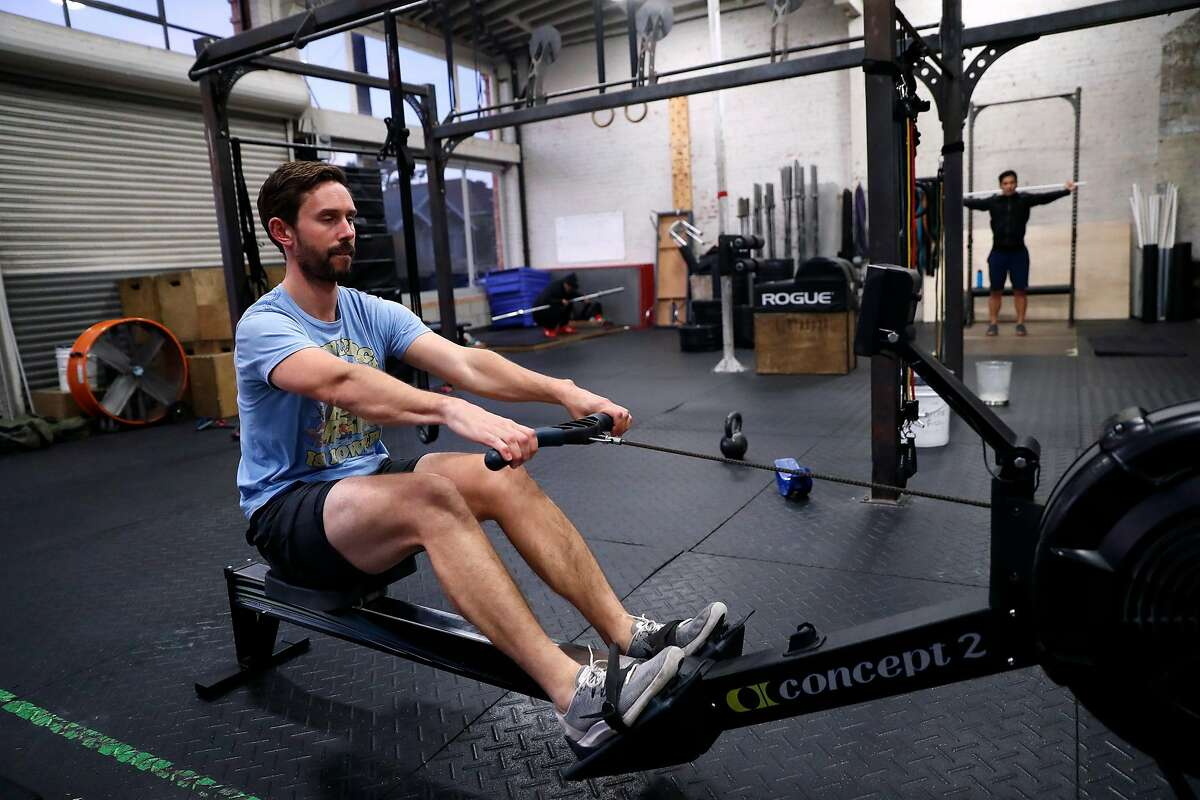 John Petersen, who recently returned from rowing a boat to Antarctica across the Drake Passage, works out at CrossFit Oakland.