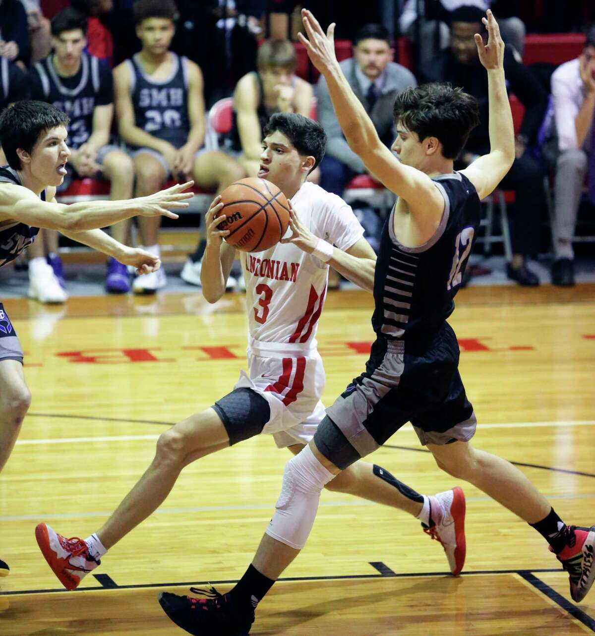 Gavin Ramos runs the floor under Avery Eugster to the hoop for the Apaches as Antonian hosts St. Mary's Hall in boys basketball at Antonian High School gym on Jan. 31, 2020.