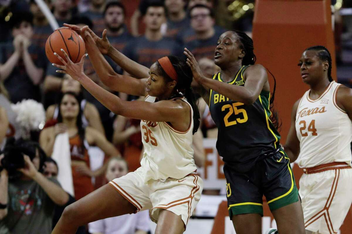 Texas forward Charli Collier (35) and Baylor center Queen Egbo (25) battle for a rebound during the second half of an NCAA college basketball game, Friday, Jan. 31, 2020, in Austin, Texas. Baylor won 64-44. (AP Photo/Eric Gay)