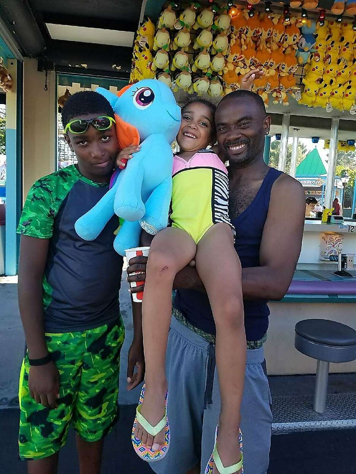 Ronell Foster, right, seen in this undated photo with his two children. Foster was fatally shot by a Vallejo police officer in February 2018. On Friday,Solano County district attorney's office announced Friday that the Vallejo police officer who fatally shot Ronnell Foster in February 2018 was justified in the fatal shooting.