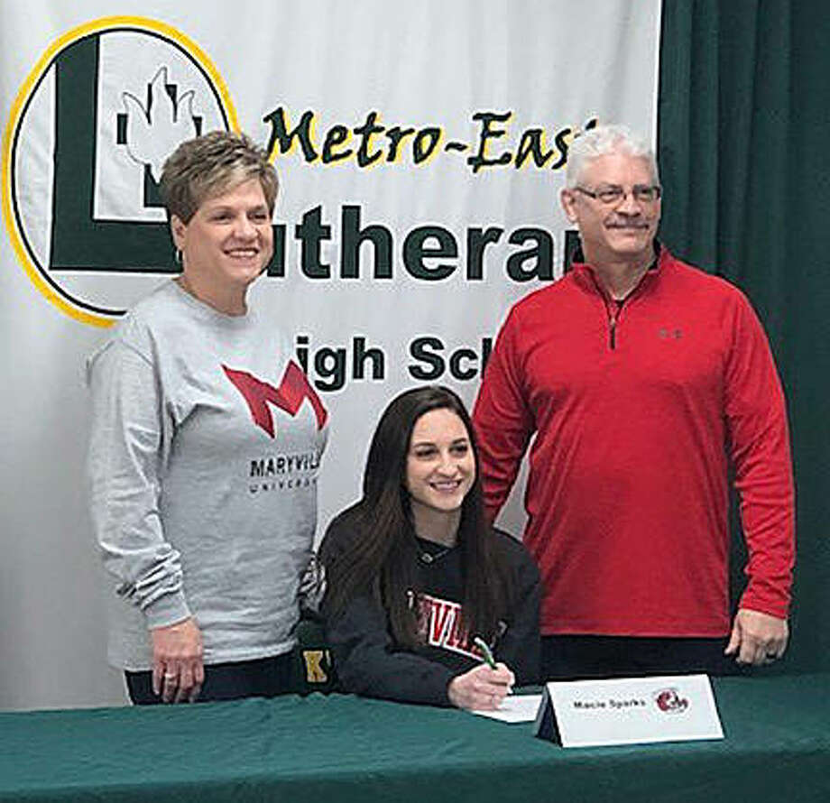 Metro-East Lutheran senior Macie Sparks is joined by her parents as she commits to compete in swimming at Maryville University in St. Louis. Photo: For The Intelligencer
