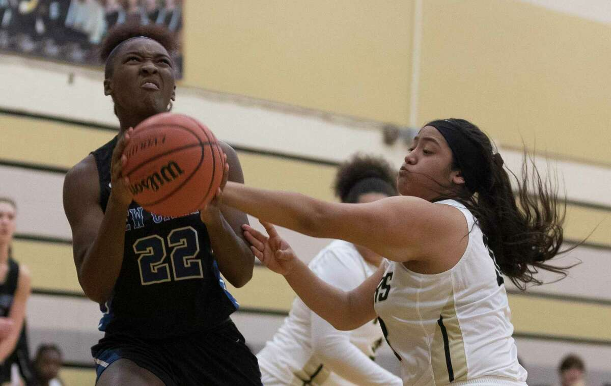 FILE PHOTO - New Caney power forward Mickayla Leftridge (22) is fouled by Conroe guard Brianna Moreno (33) in the first quarter of a high school girls basketball game during the Lady Tiger Classic at Conroe High School, Thursday, Nov. 14, 2019, in Conroe.