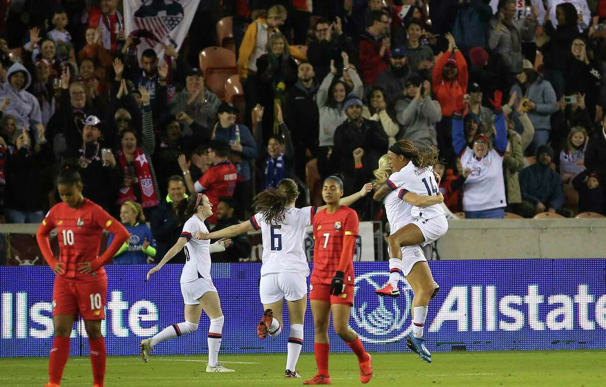 The United States forward Jessica McDonald (14) jumps into midfielder Lindsey Horan's arms to celebrate Horan's goal during the first half of the CONCACAF Women's Olympic Qualifying Tournament match against the Panama Friday, Jan. 31, 2020, at BBVA Stadium in Houston.
