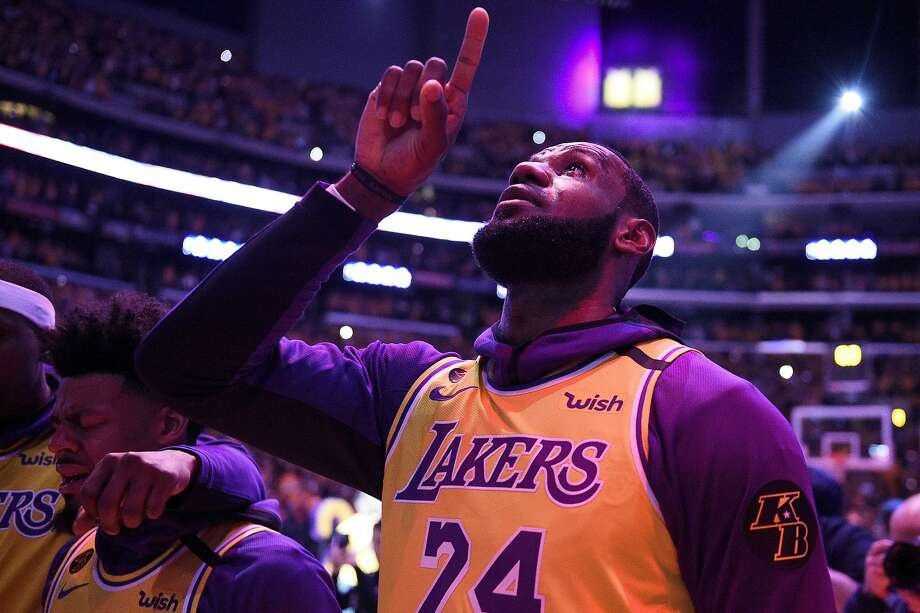 The Lakers' LeBron James points to the rafters in tribute to the late Lakers star, Kobe Bryant. Photo: Kelvin Kuo / Associated Press