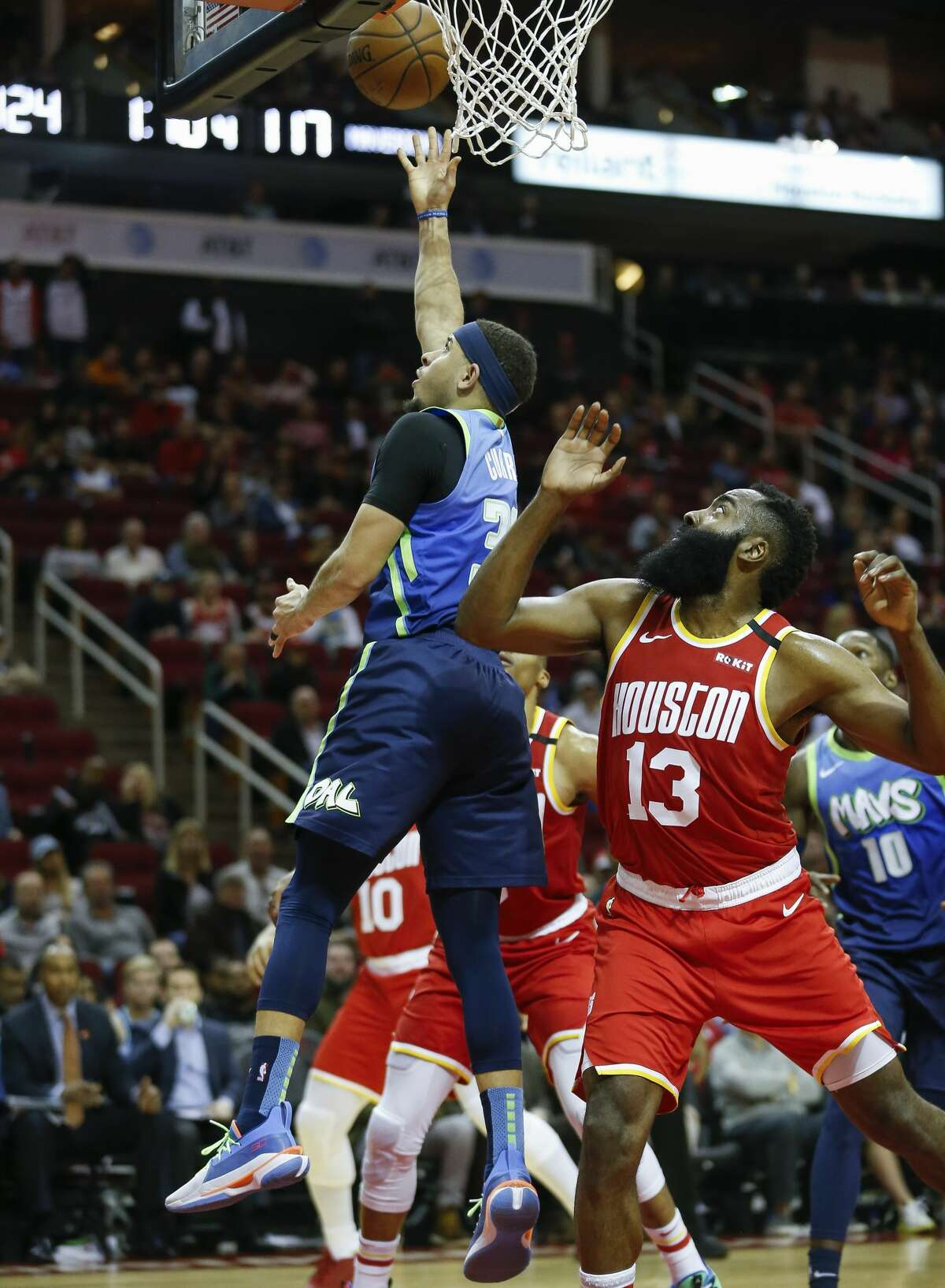 Dallas Mavericks guard Seth Curry (30) scores on layup against Houston Rockets guard James Harden (13) during the second half of an NBA game at the Toyota Center Friday, Jan. 31, 2020, in Houston. The Rockets won 128-121.