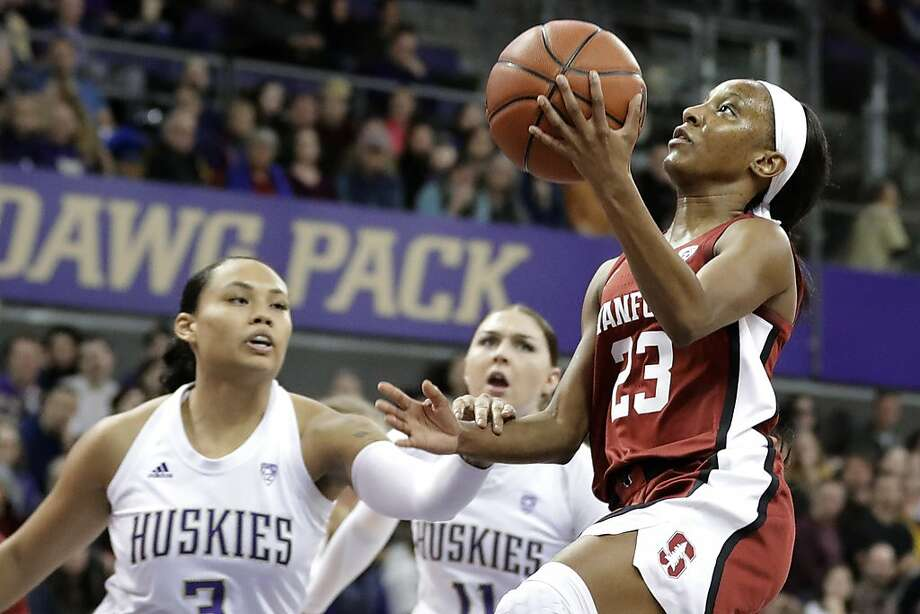 Stanford guard Kiana Williams (right) rises for a layup against Washington defenders. Photo: Ted S. Warren / Associated Press