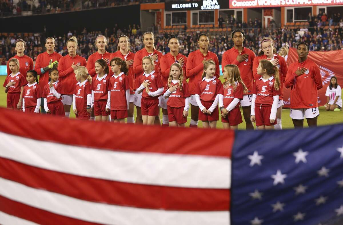 The United States starting lineup sing the national anthem at the CONCACAF Women's Olympic Qualifying Tournament match against the Panama Friday, Jan. 31, 2020, at BBVA Stadium in Houston.
