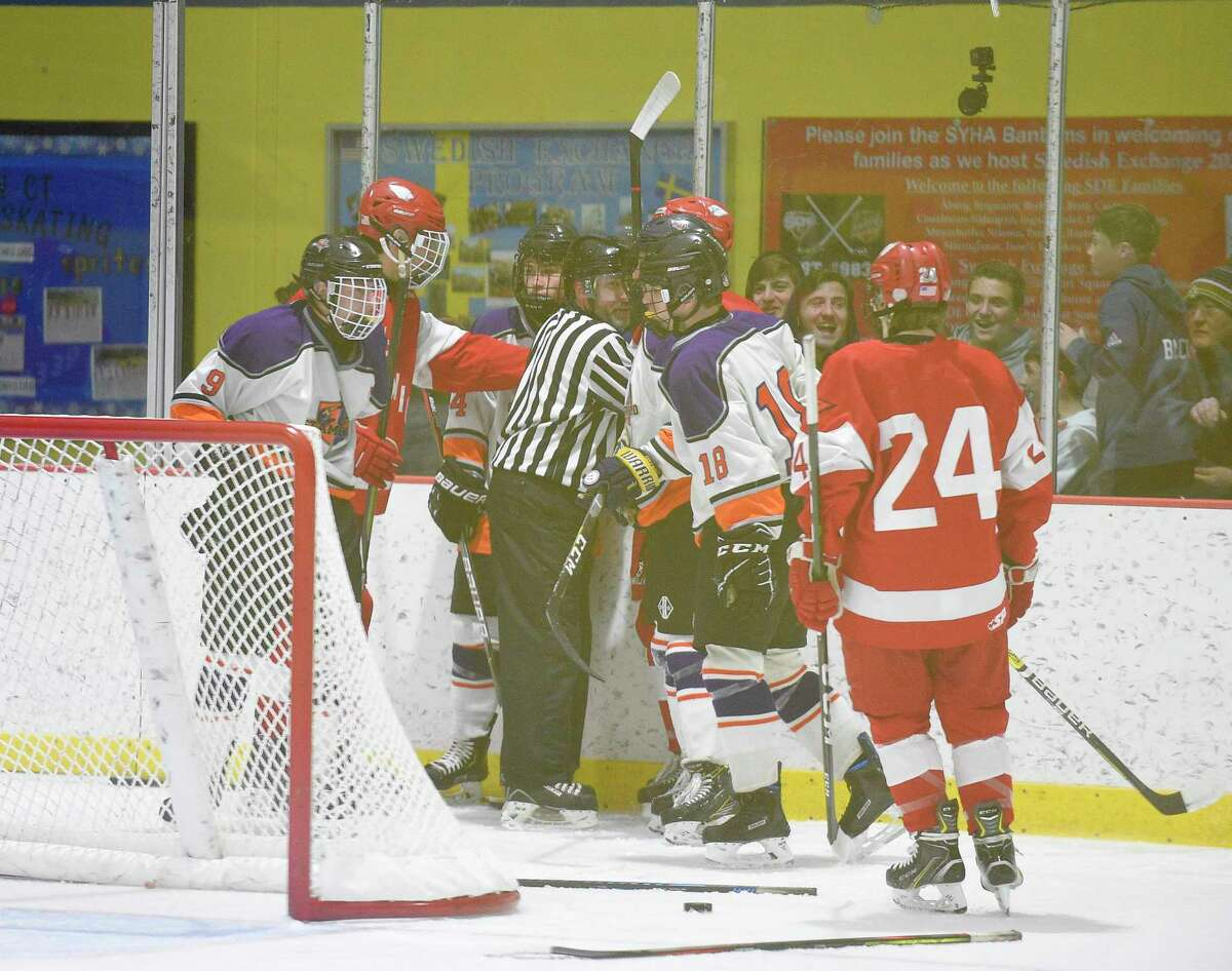 A minor skirmish breaks out as the clock expires in the third period of Greenwich Stamford-Westhill Co-op FCIAC boys hockey game at Terry Connors Ice Rink on Jan. 31, 2020. Greenwich won 3-1.