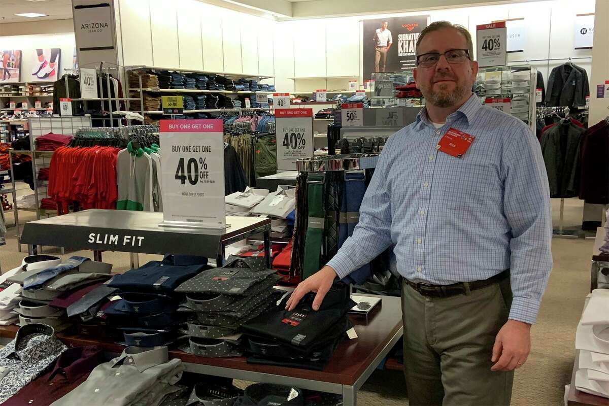 JCPenney manager Rick Swinson stands beside a display of men's shirts marked 40% off Wednesday.JCPenneywill add another 30% off of career wear for Ferris students during its Suit-Up Event from noon to 3 p.m. Feb. 9. (Pioneer photo/Julie Norwood)