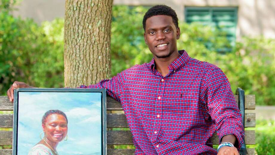 Inspirational speaker Chris Singleton (pictured with a portrait of his late mother, Sharonda Coleman Singleton) was the guest at FSU's Entertainment Unlimited Campus Programming Board Thursday. (Courtesy photo)