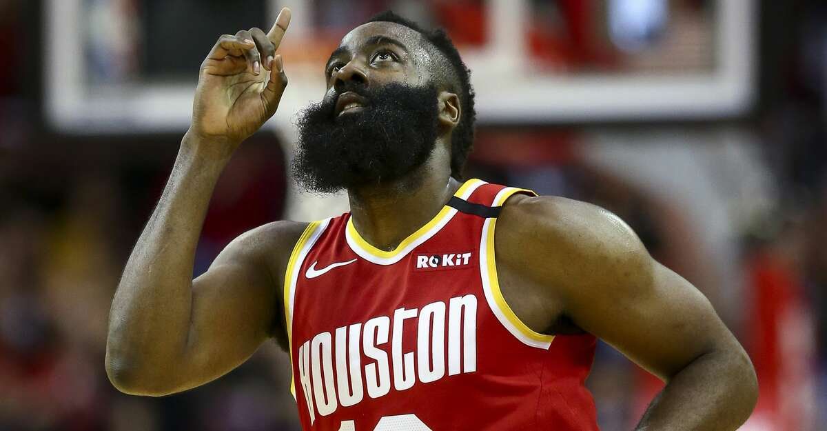 Houston Rockets guard James Harden (13) points to the sky after scoring against the Dallas Mavericks during the second half of an NBA game at the Toyota Center Friday, Jan. 31, 2020, in Houston. The Rockets won 128-121.