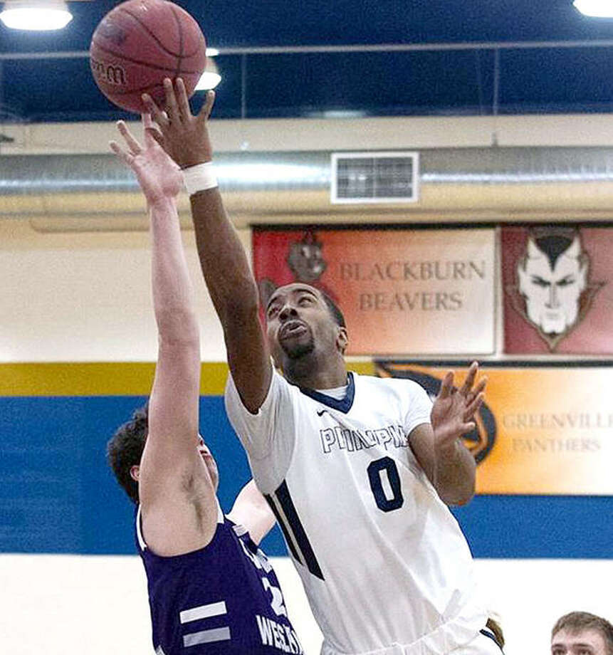 Trevaughn Goodman, right, broke the Principia College NCAA Division III career scoring mark with a 26-point effort Tuesday at Eureka. Photo: Principia Athletics