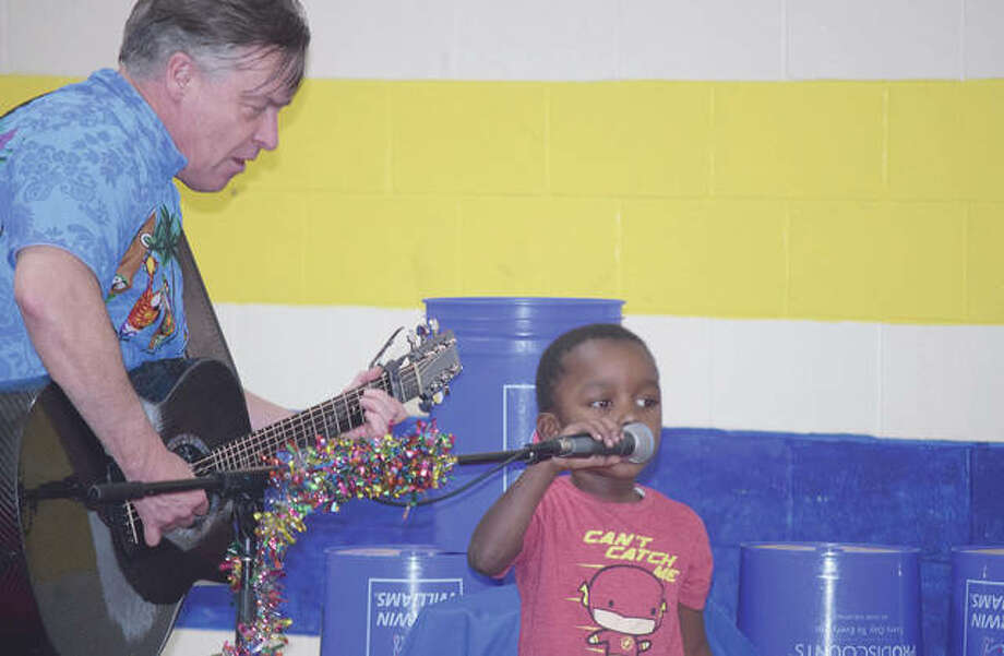 Skee Sanders sings the ABCs with Mr. Babaloo, aka Rob Compton, on Friday as part of the Early Years Program. Mr. Babaloo performed several songs and skits for the students.
