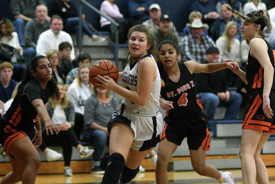 Concordia Lutheran senior forward Kiersten Rich, center, drives to the hoop between a trio of St. Pius defenders during the second quarter of their district matchup at CLHS on Jan. 31, 2020. Photo: Jerry Baker, Houston Chronicle / Contributor / Houston Chronicle