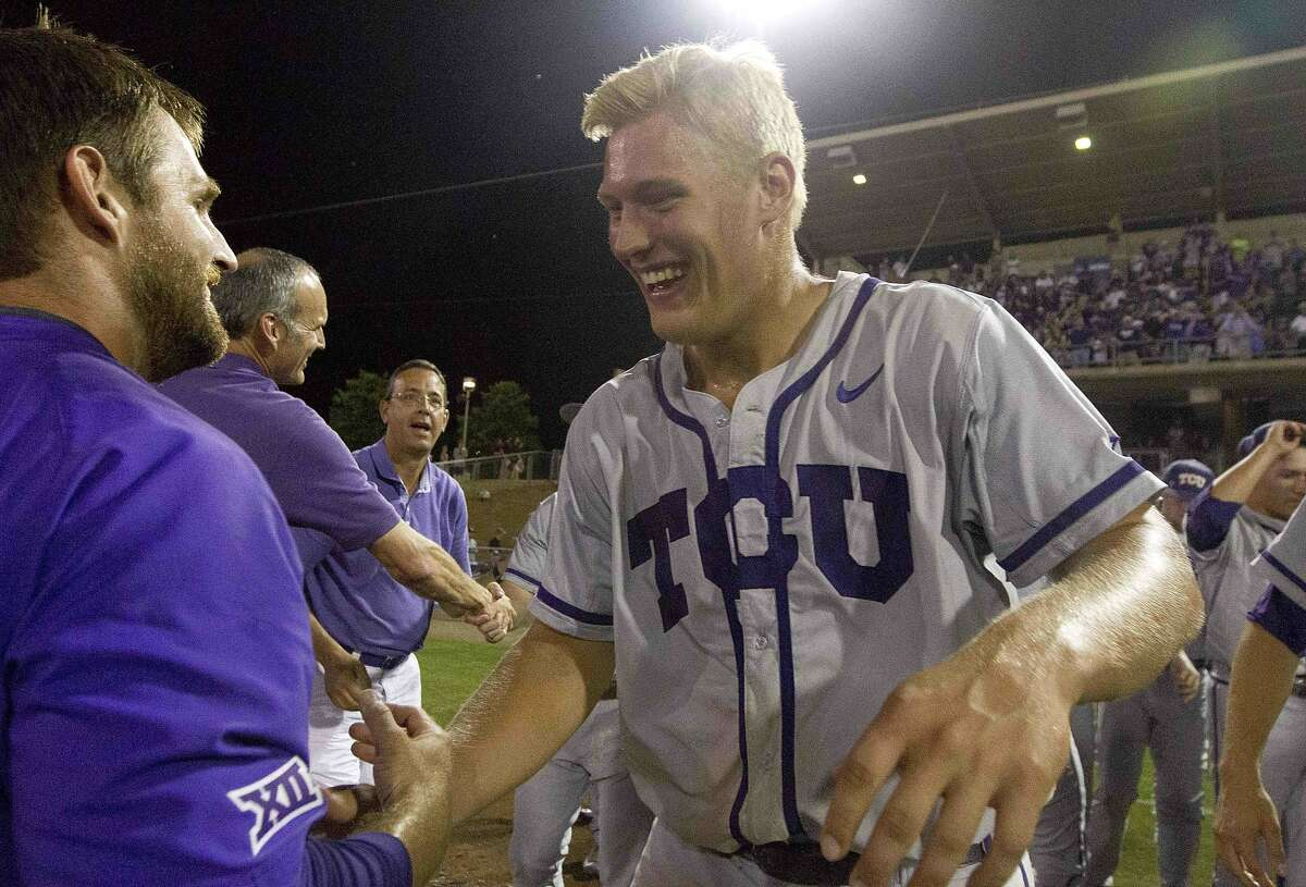 TCU's Luken Baker celebrates after defeating Texas A&M 4-1 in NCAA college baseball super regional tournament game Sunday, June 12, 2016, in College Station, Texas.