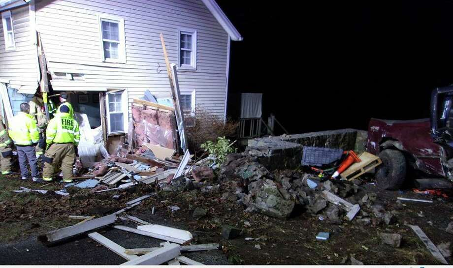 Damage to a house in Newtown, Conn. after police say a driver drove his truck into it on Feb. 1, 2020. The driver faces multiple charges, including one count of driving while intoxicated. Photo: Courtesy Of The Newtown Police Department