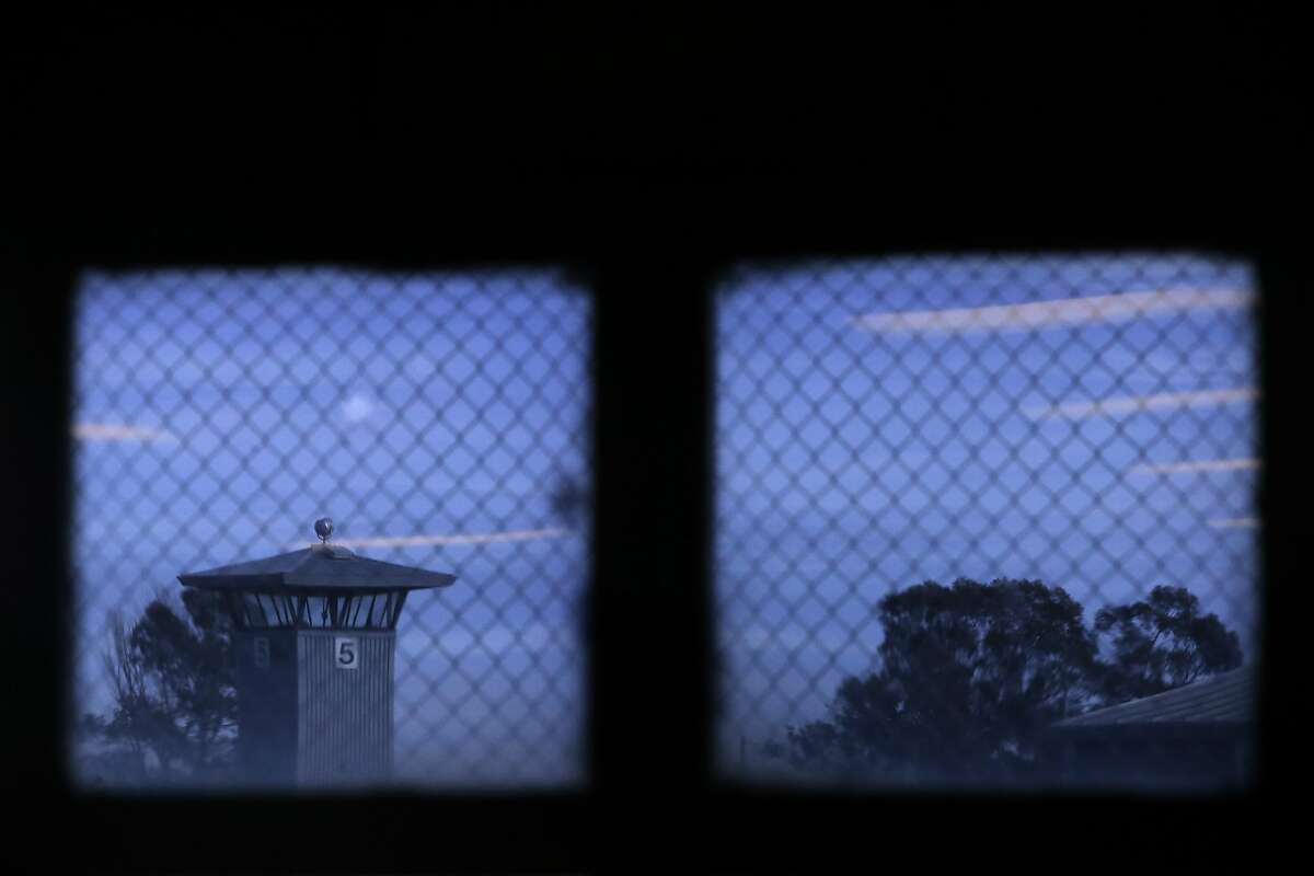A guard tower looms outside as Defy Ventures holds a business pitch competition inside for prisoners enrolled in the entrepreneurs in training program, at Solano State Prison in Vacaville, Calif. on Thursday December 17, 2015.