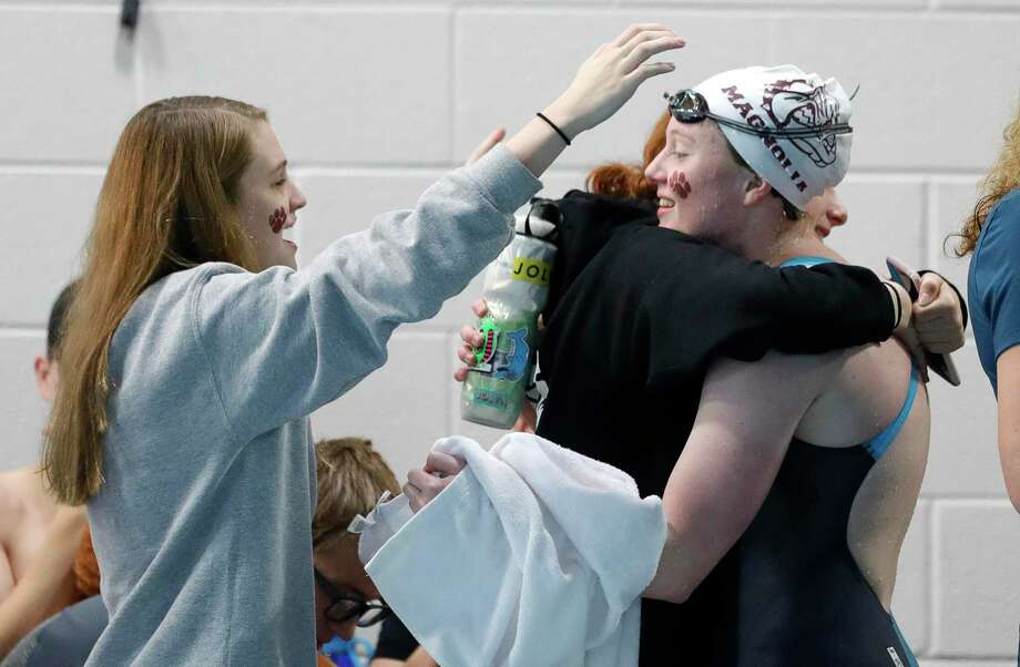 Kailey Turner of Magnolia gets a hug after finishing first in the girls 200-yard freestyle during the Region VI-5A swimming championships at the Michael D. Holland Aquatic Center, Saturday, Feb. 1, 2020, in Magnolia. Photo: Jason Fochtman, Houston Chronicle / Staff Photographer / Houston Chronicle © 2020
