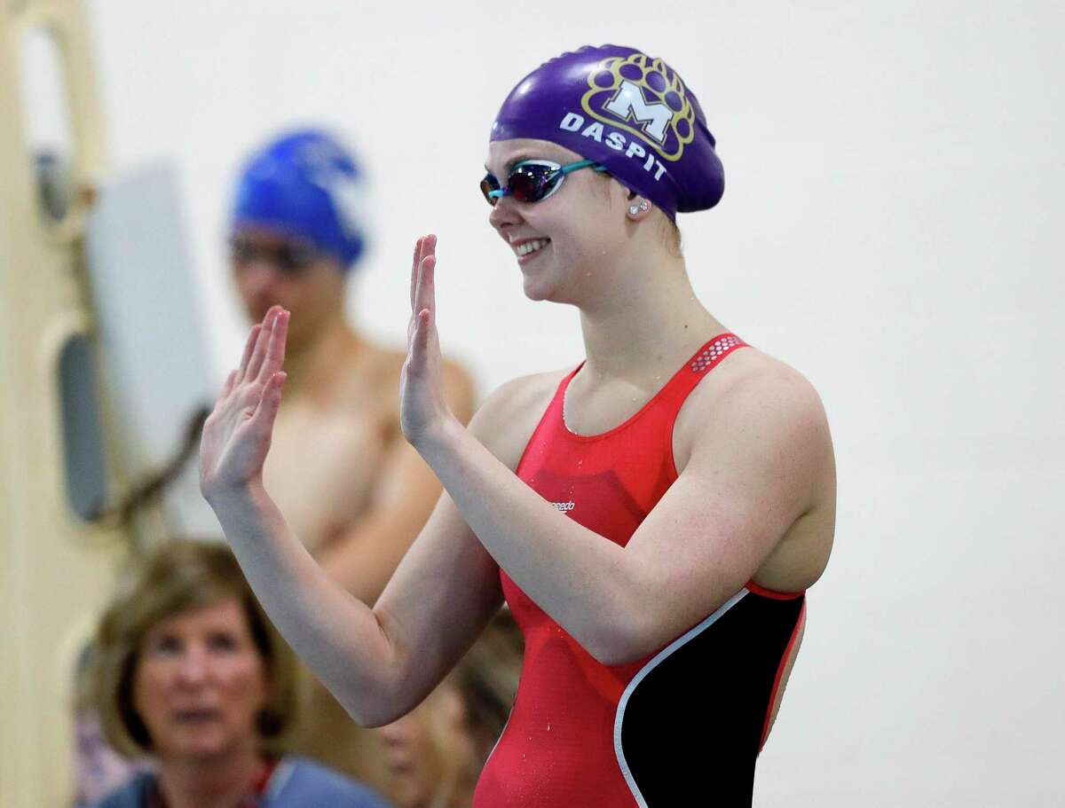JoJo Daspit of Montgomery waves to fans before competing in the girls 50-yard freestyle during the Region VI-5A swimming championships at the Michael D. Holland Aquatic Center, Saturday, Feb. 1, 2020, in Magnolia.