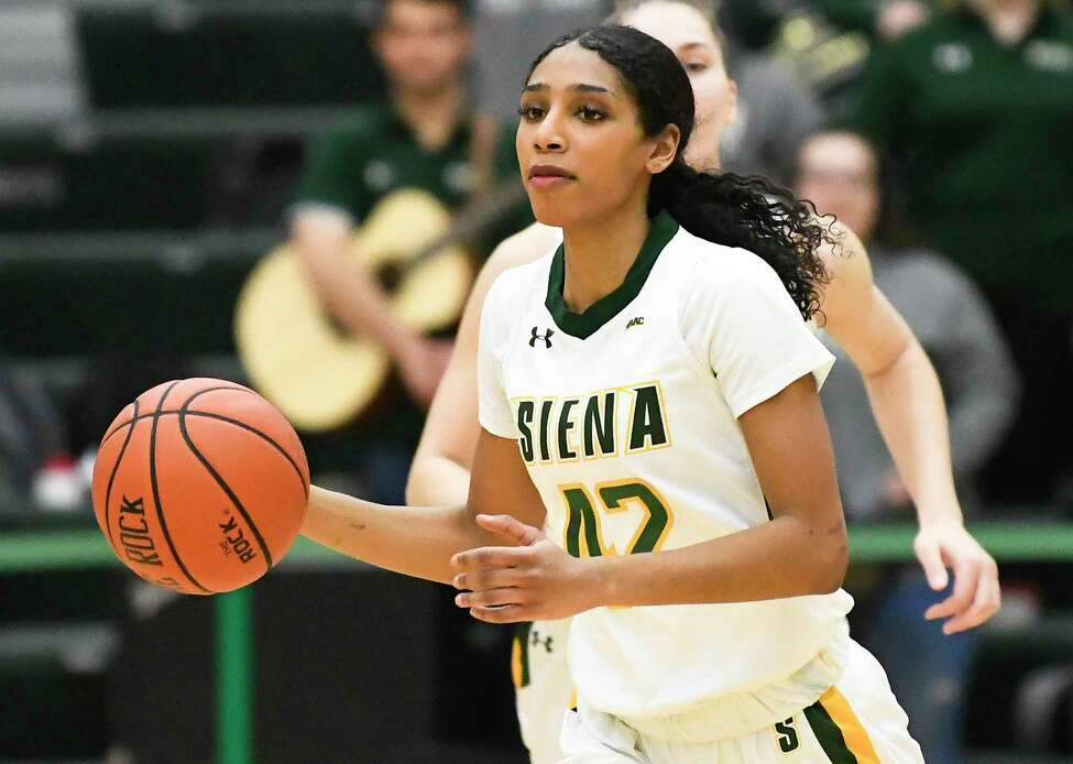 Siena guard Sabrina Piper (42) moves the ball against the Canisius during the first half of a NCAA women's college basketball game, Saturday, Feb. 1, 2020, in Loudonville, N.Y.