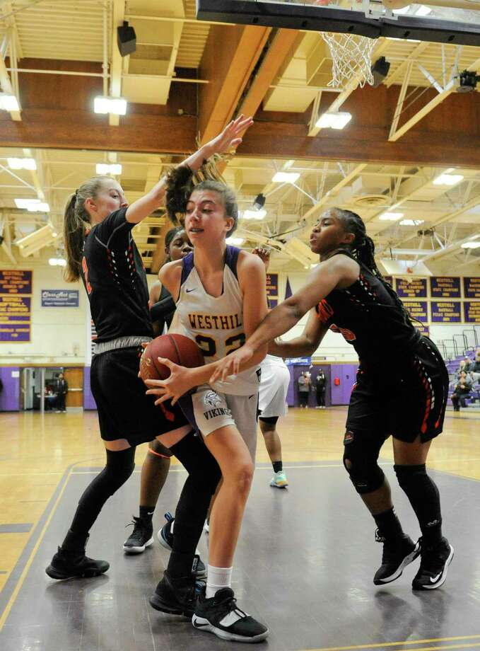 Westhill's Audra Hansen (22) looks to pass under pressure from Stamford's Megan Landsiedel (2) and Jessica Nelson (10) in first half of a girls basketball game at Westhill High School in Stamford on Saturday. Stamford won 49-29. Photo: Matthew Brown / Hearst Connecticut Media / Stamford Advocate