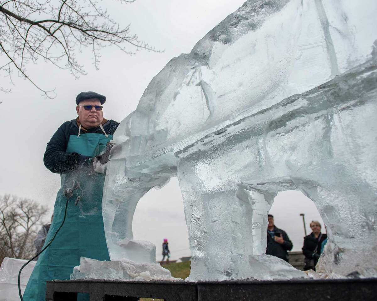 Jim Nadeau, of Nadeau's Ice Sculptures, carves a mastodon out of a block of ice at the Cohoes Winter Carnival at the Van Schaick Island Pond to kick off the city's 150th anniversary year on Saturday, Feb. 1 2019 (Jim Franco/Special to the Times Union.)