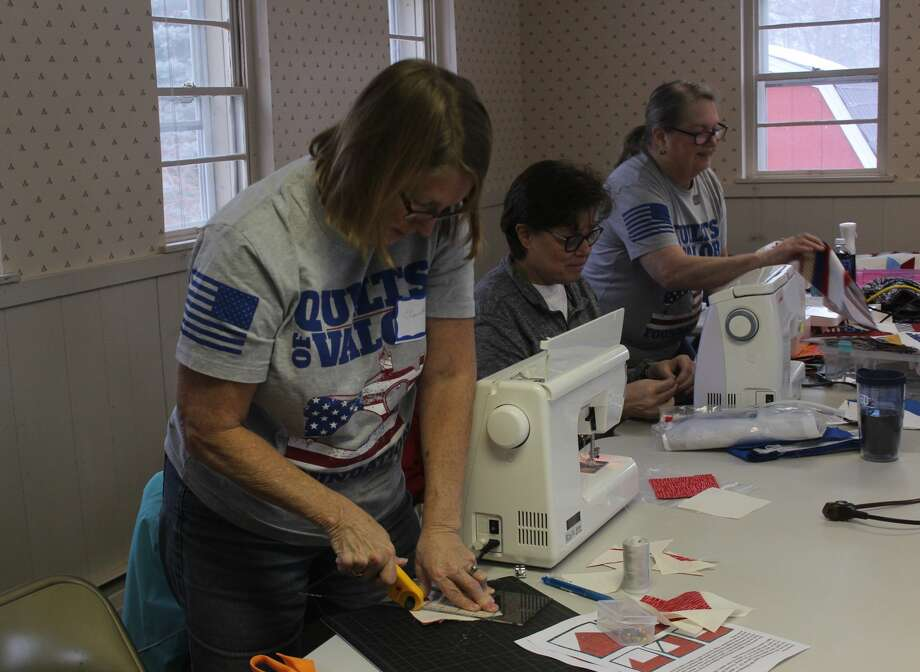 The Big Rapids chapter of the Quilts of Valor participated in National Sew Day at the Old Jail this weekend. During the event, attendees made quilts for local veterans, while also enjoying activities, prizes and food. Photo: (Pioneer Photo/Taylor Fussman)