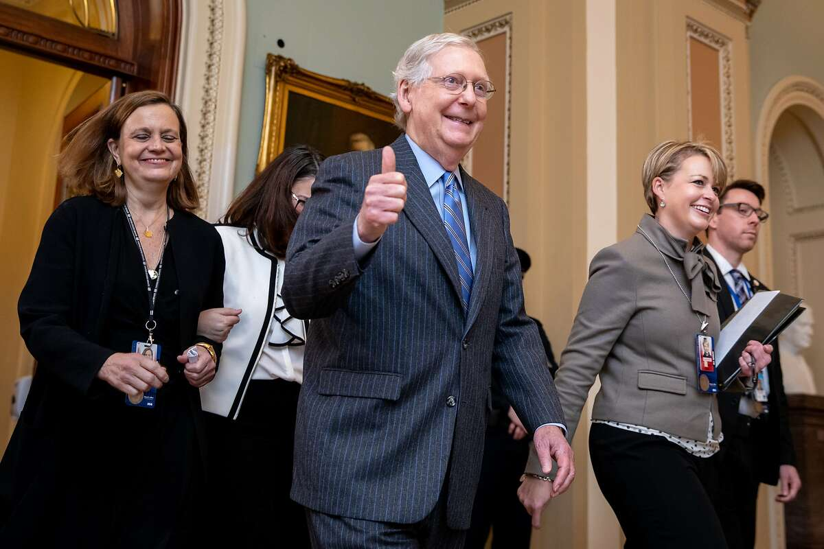 Senate Majority Leader Mitch McConnell gestures a thumbs-up at the U.S. Capitol in Washington, D.C., U.S., on Jan. 31, 2020, after Republicans secured enough votes to block the introduction of new evidence in President Donald Trump's impeachment trial.
