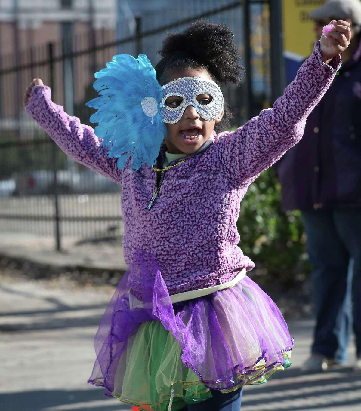 Brielle Vann, 5, enjoys the 7th Annual Houston Creole Mardi Gras Parade Saturday, Feb. 1, 2020, in Houston.