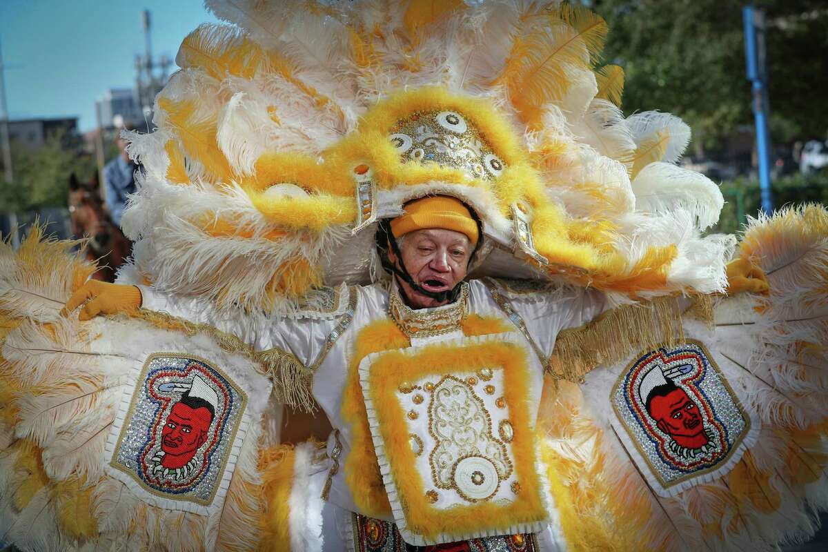 Chief Percy Pichon (75-years-old) of the Young Creole Cherokee Mardi Gras Indians walks in the 7th Annual Houston Creole Mardi Gras Parade Saturday, Feb. 1, 2020, in Houston.