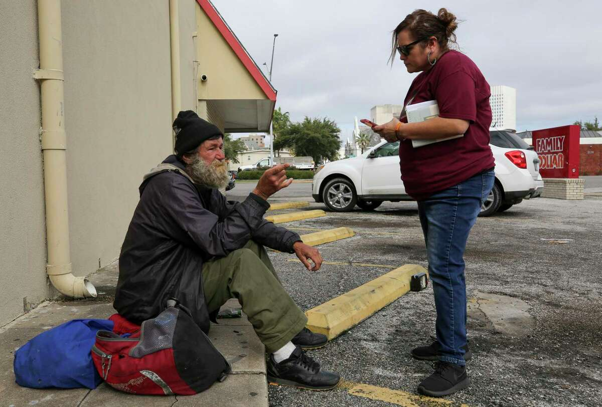 Hilda Tobias talks to William C. Wilkins during the annual Point-in-Time Count on Thursday, Jan. 23, 2020, in Galveston, Texas. Tobias is the director of child and family safety networks at the Children's Center. Wilkins has been homeless in Galveston since Hurricane Ike.