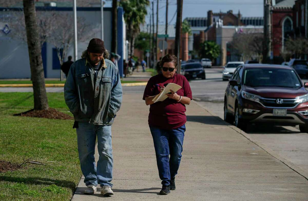 Hilda Tobias talks to a man who is currently homeless during the annual Point-in-Time Count on Thursday, Jan. 23, 2020, in Galveston, Texas. Tobias is the director of child and family safety networks at the Children's Center.