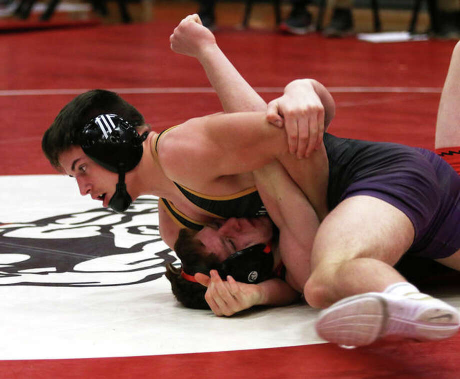 CM' Colton Carlisle (top) finishes off his pin of Triad's Sam Wheeler at 2:29 in their 152-pound bout Saturday at the Mississippi Valley Conference wrestling duals in Highland. Carlisle went 5-0 on the day. Photo: Greg Shashack | The Telegraph