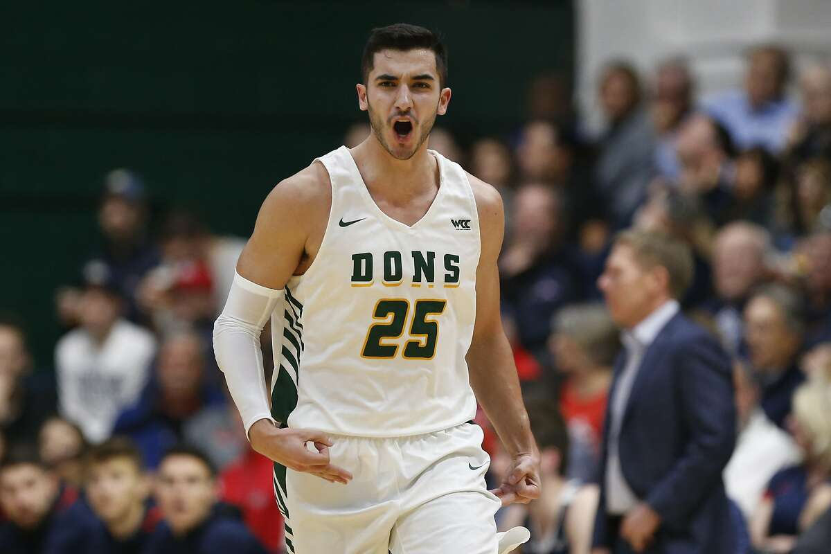 San Francisco guard Jordan Ratinho (25) celebrates after a three-point basket against Gonzaga during the first half of an NCAA college basketball game in San Francisco, Saturday, Feb. 1, 2020. (AP Photo/Jed Jacobsohn)