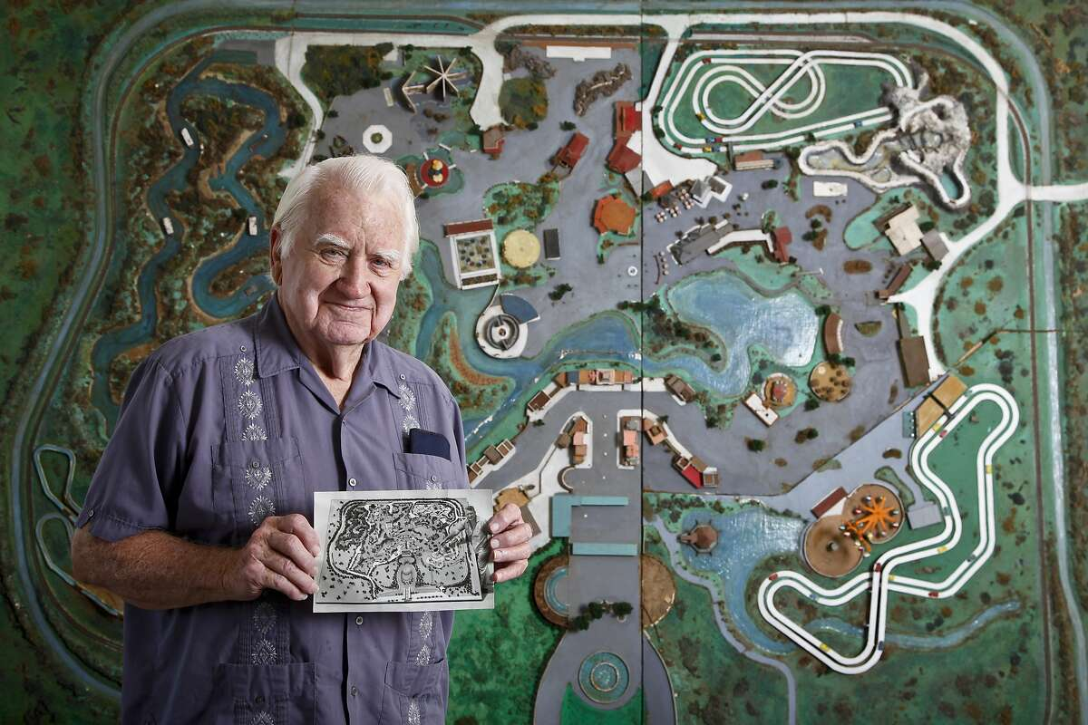 Ed Henderson holds a photograph of himself as he stands in front of his original Astroworld model he created in 1967 at Roy Hofheinz' request to help promote the new amusement park, Monday, June 27, 2011, in Houston. Henderson was a former Disney animator and also the creator of Astrodome scoreboard animations. ( Michael Paulsen / Houston Chronicle )