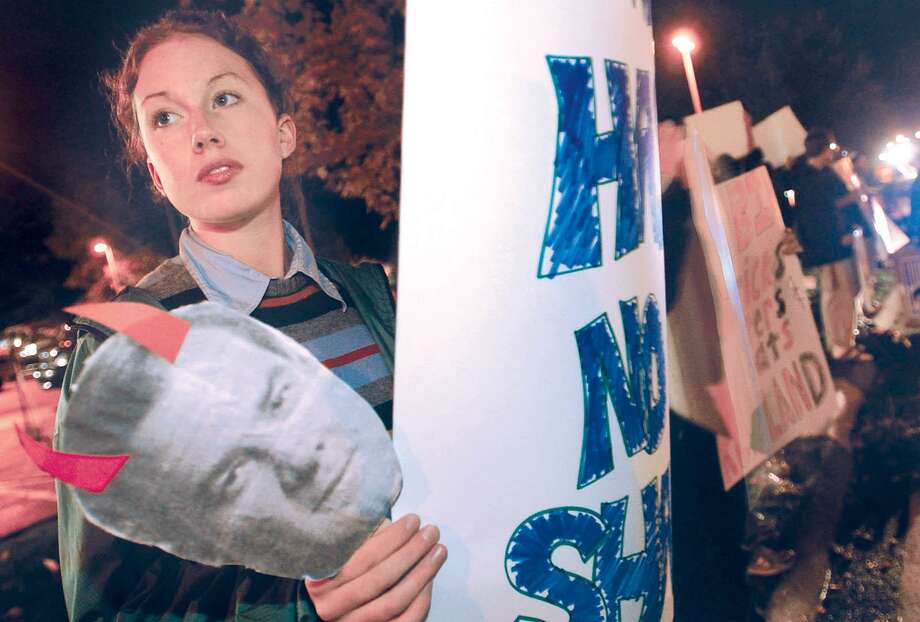 Wesleyan University student Jenny Ryan, a member of Wesleyan Students for Clean Elections, stands outside the Radisson Hotel and Conference Center in Cromwell as part of a protest during the 188th annual Connecticut Business and Industry Association meeting in 2003. Protesters called for Gov. John Rowland's removal from office and for the reform of campaign finance laws. Photo: /