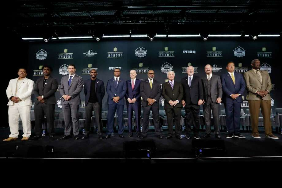 Hall of Fame Class of 2020, from left, Troy Polamalu, Edgerrin James, Steve Hutchinson, Isaac Bruce, Steve Atwater, Paul Tagliabue, Donnie Shell, Jimmie Johnson, Cliff Harris, Bill Cowher, Jimbo Covert, and Harold Carmichael pose at the NFL Honors football award show Saturday, Feb. 1, 2020, in Miami. (AP Photo/Mark Humphrey) Photo: Mark Humphrey, Associated Press / Copyright 2020 The Associated Press. All rights reserved.