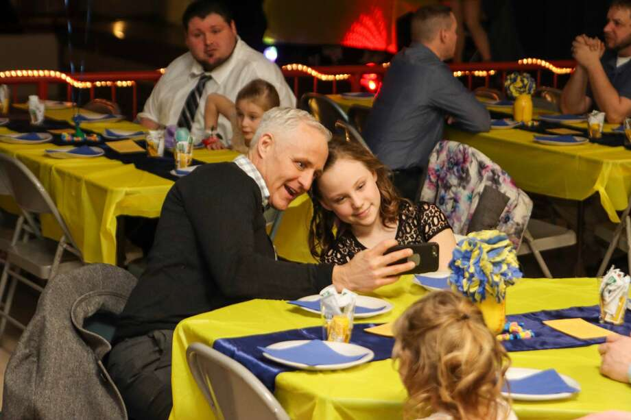 Scott and Julie Gordon take a selfie at the Blue and Gold Ball in Bad Axe Feb. 1. Photo: Scott Nunn/Huron Daily Tribune