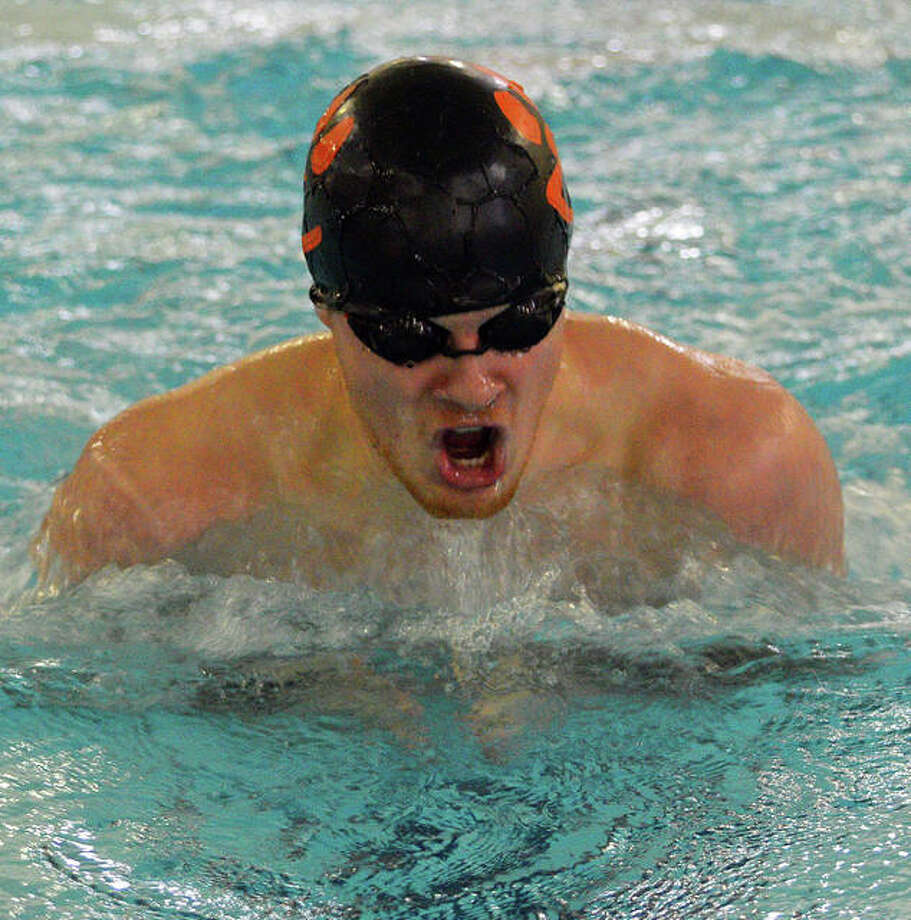 Edwardsville's McLain Oertle swims in the 100-yard breaststroke during Saturday's meet against Sacred Heart-Griffin and Springfield High at Chuck Fruit Aquatic Center.