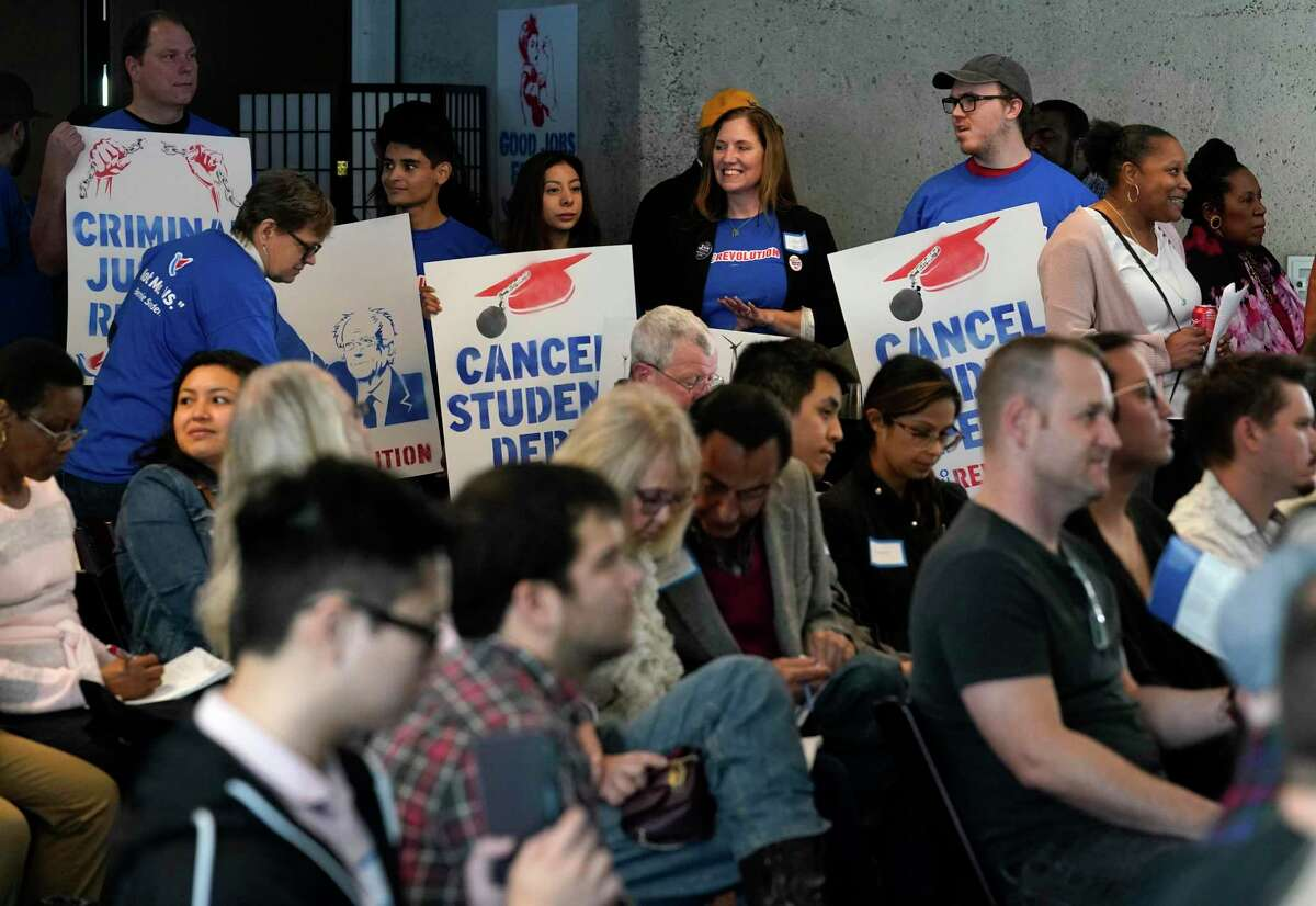 People attend the Our Revolution Texas Summit held at the Alley Theatre Saturday, Feb. 1, 2020, in Houston. Activists for Bernie Sanders and supporters gathered to organize in an effort to flip the 9 Texas House seats and to put an end to gerrymandering.