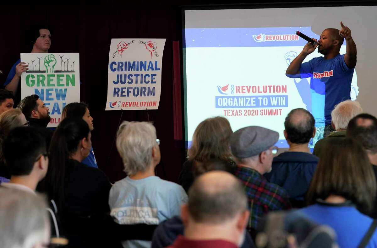 Tony Tig, right, performs at the Our Revolution Texas Summit held at the Alley Theatre Saturday, Feb. 1, 2020, in Houston. Activists for Bernie Sanders and supporters gathered to organize in an effort to flip the 9 Texas House seats and to put an end to gerrymandering.