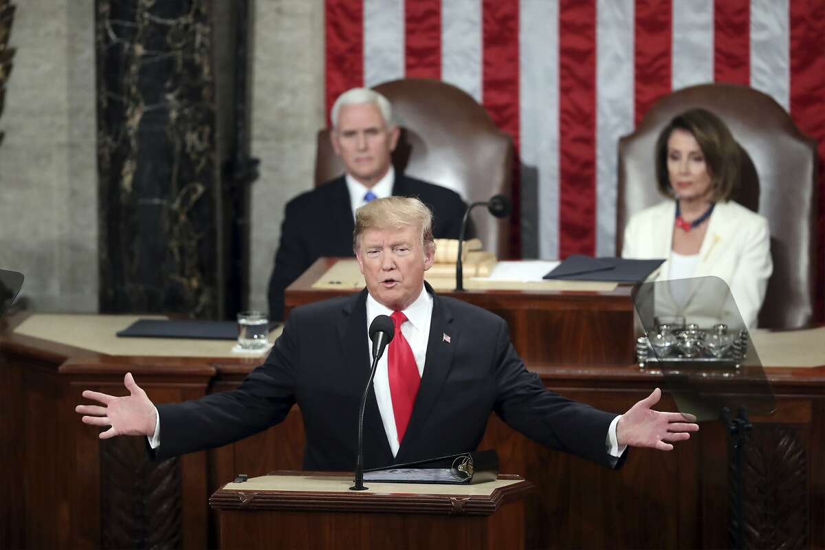 FILE - In this Feb. 5, 2019, file photo, President Donald Trump delivers his State of the Union address to a joint session of Congress on Capitol Hill in Washington, as Vice President Mike Pence and Speaker of the House Nancy Pelosi, D-Calif., watch.