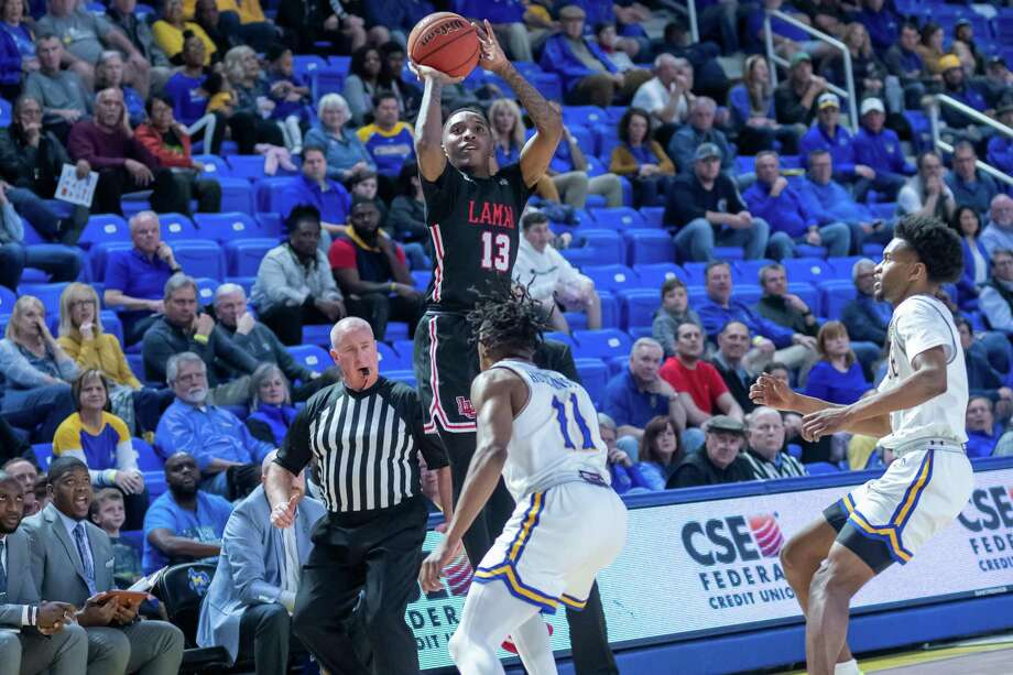 Davion Buster (13) puts up a three-pointer for three of his 39 points in the game as the Lamar Cardinals headed to Lake Charles to take on the McNeese Cowboys on February 1, 2020. Fran Ruchalski/The Enterprise Photo: Fran Ruchalski/The Enterprise / 2019 The Beaumont Enterprise