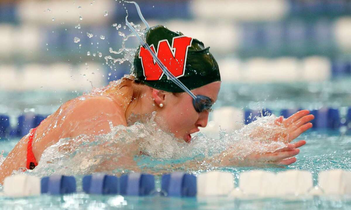 The Woodlands competes in the girls 200-yard medley relay during the Region IV-6A swimming championships at the Conroe ISD Natatorium, Saturday, Feb. 1, 2020, in Shenandoah.