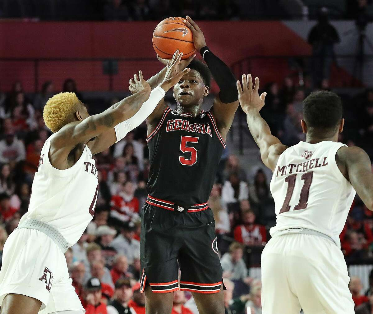 Georgia's Anthony Edwards shoots over a double-team by Texas A&M's Jay Jay Chandler, left, and Wendell Mitchell (11) during the first half on Saturday, Feb. 1, 2020, at Stegeman Coliseum in Athens, Ga. Georgia won, 63-48. (Curtis Compton/Atlanta Journal-Constitution/TNS)