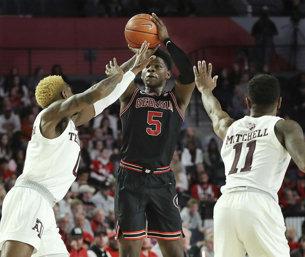 Georgia guard Anthony Edwards shoots over a double team by Texas A&M defenders Jay Jay Chandler, left, and Wendell Mitchell (11) during the first half of an NCAA college basketball game, Saturday, Feb. 1, 2020, in Athens. (Curtis Compton/Atlanta Journal-Constitution via AP)