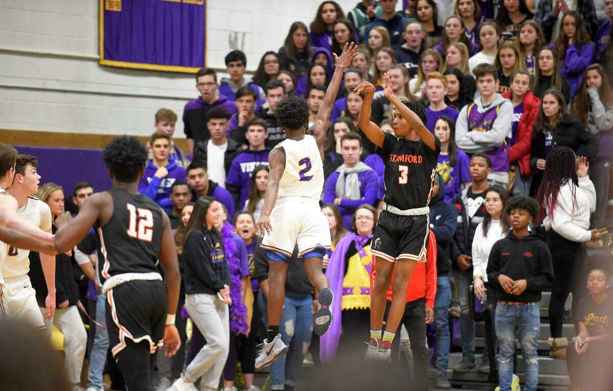 Stamford's Damani Taylor (3) follows his fade away three pointer in the third quarter against Westhill in a boys basketball game of the MLK Classic Basketball Tournament at Westhill High School in Stamford, Conn. on Feb. 1, 2020. Taylor shot, the turning point and go ahead basket helped Stamford defeat Westhill 57-51 .